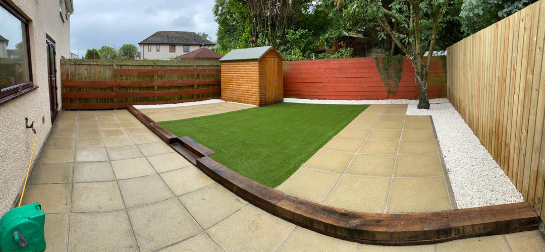 Full garden landscaped with artificial grass, new paving, Spanish oak sleepers and planters