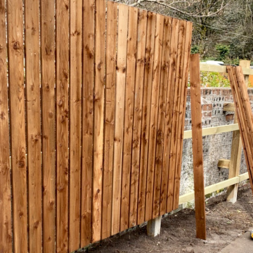 6ft garden fencing erected in front of existing old wall.